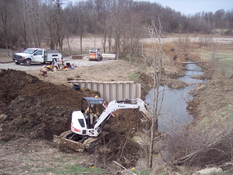 Construction of ditch plug for wetland restoration
