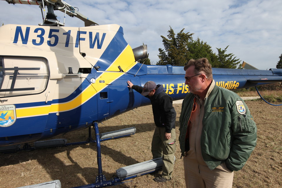 U.S. Fish and Wildlife Service pilots do pre-flight check (NJ)
