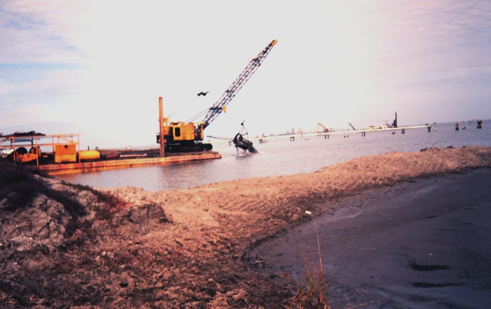 The Greenhill/East Timbalier dredging operation  -- bucket dredge scooping material from channel which will be sent by pipe to the marsh creation site.