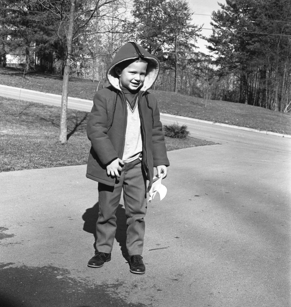 Young student waiting on School Bus Oak Ridge 1968