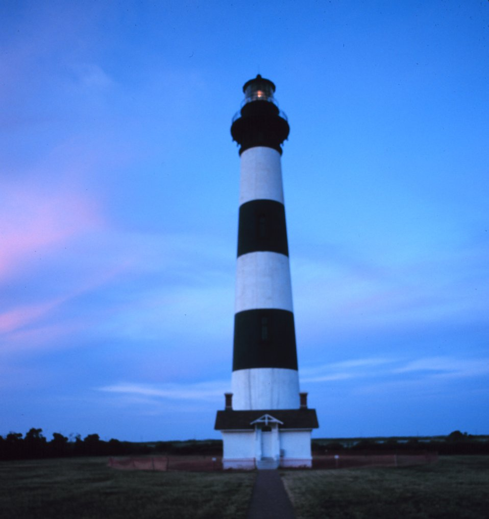 A view of the Bodie Island Lighthouse at sunset