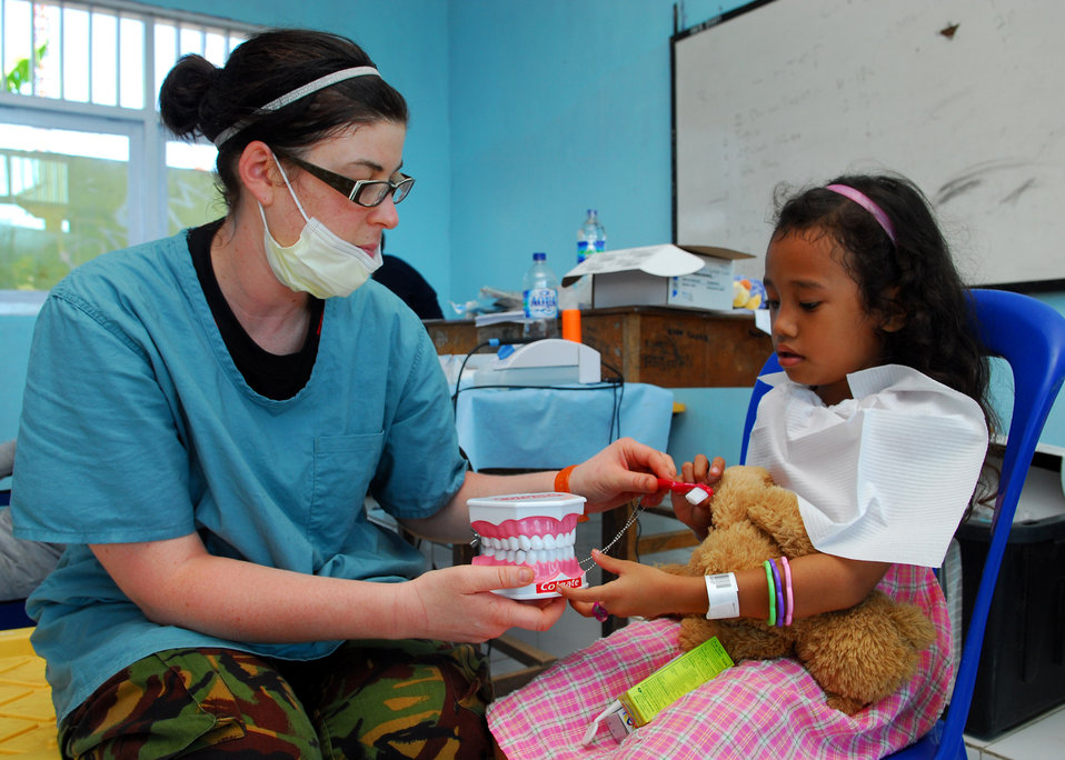 Royal New Zealand Dental Corps Corporal Amy Kelly Gives Dental Hygiene Instructions to a Child