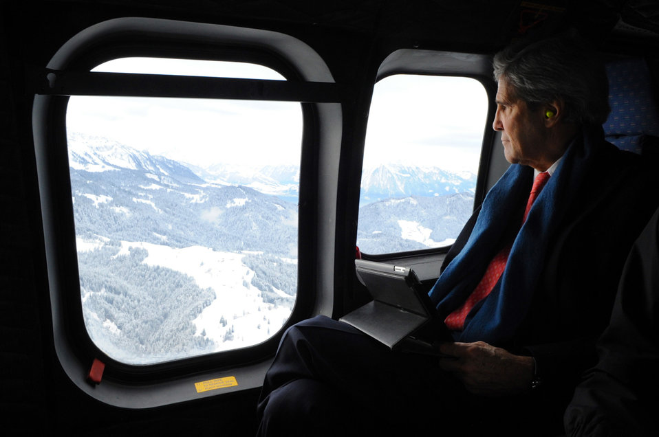 Secretary Kerry Looks Out at Swiss Landscape on Flight to Davos