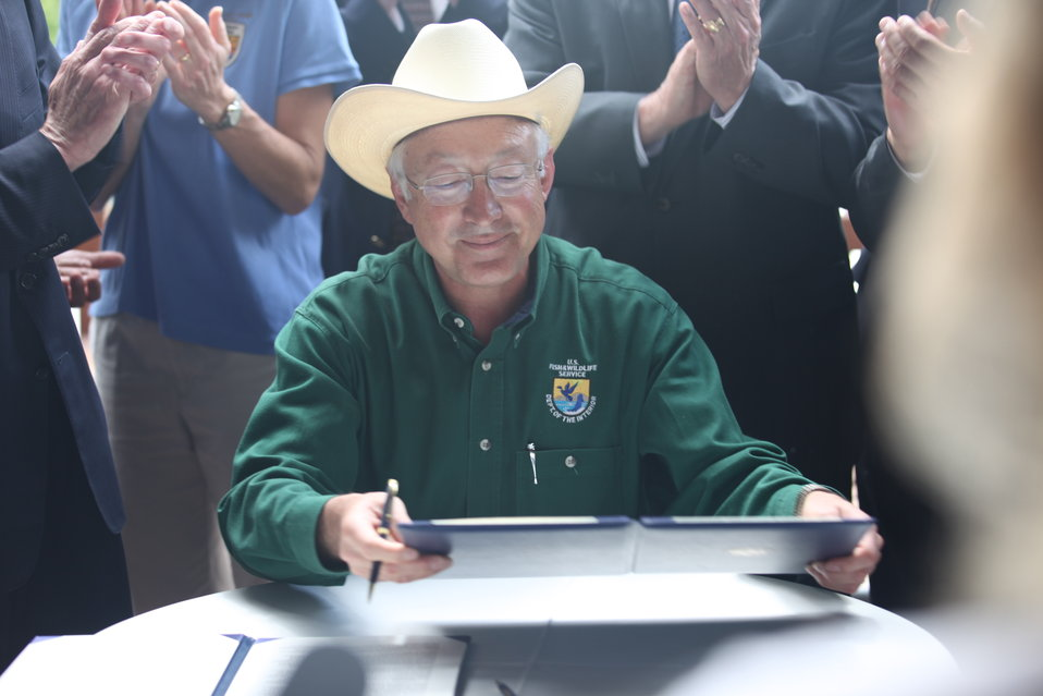 Ken Salazar happy signing