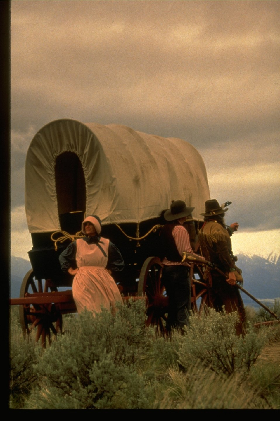 Re-enactment with pioneers and wagon.