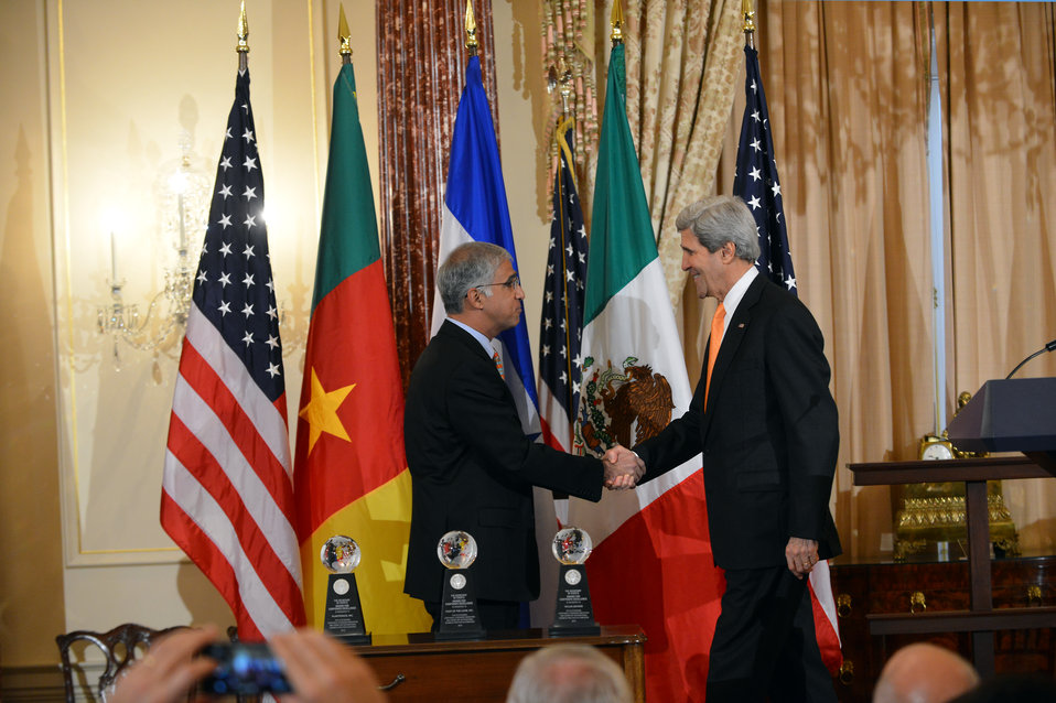 Secretary Kerry Shakes Hands With CEO Kannappan of Plantronics, Inc.
