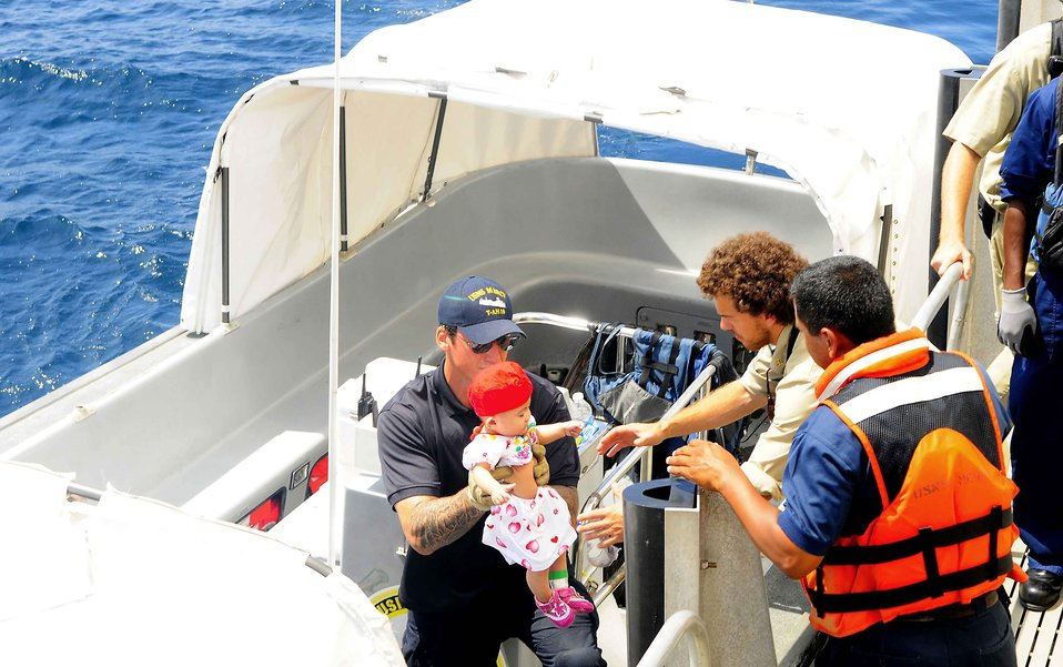 Two Civilian Mariners Work Together to Safely Embark an Infant Medical Patient