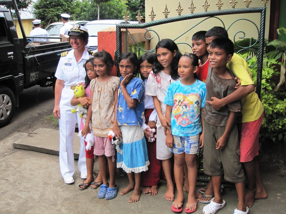 PP2010 Commander Capt. Franchetti Poses for a Photo With Indonesian Orphans