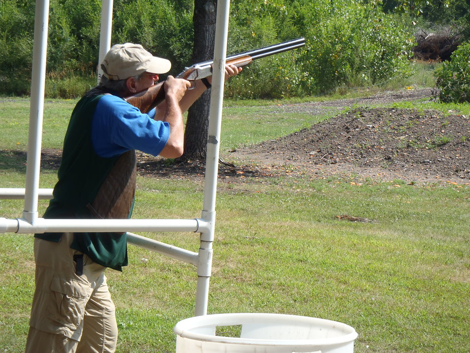 Regional Director Tom Melius takes aim. Service photo.