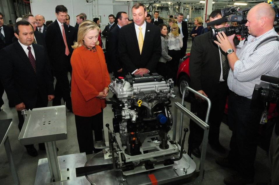 GM Uzbekistan General Director Spendel Shows a Completed Engine to Secretary Clinton and Uzbek Deputy Prime Minister Rozukulov