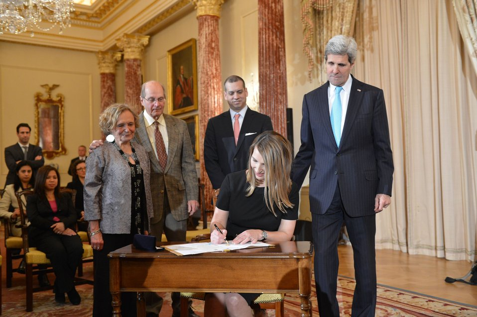 Deputy Secretary Higginbottom Signs her Appointment Papers