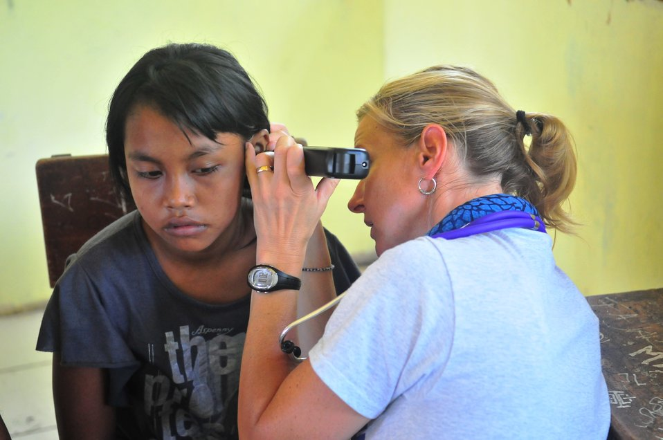 Project HOPE Nurse Practitioner Gabrielle Seibel Gives an Ear Exam to an Indonesian Girl