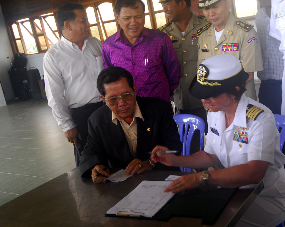 Cambodian Ministry of Culture Director and Capt. Franchetti Sign Document