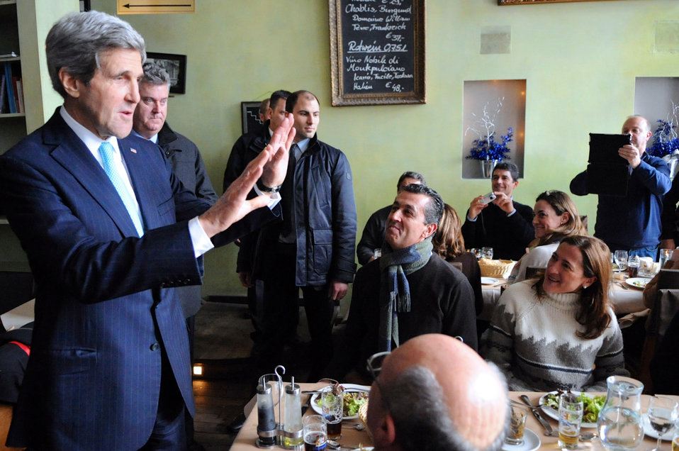 Secretary Kerry Greets Spanish Tourists After a Stop at a Berlin Restaurant