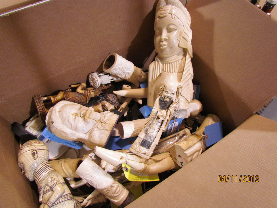Single box of small ivory carvings
