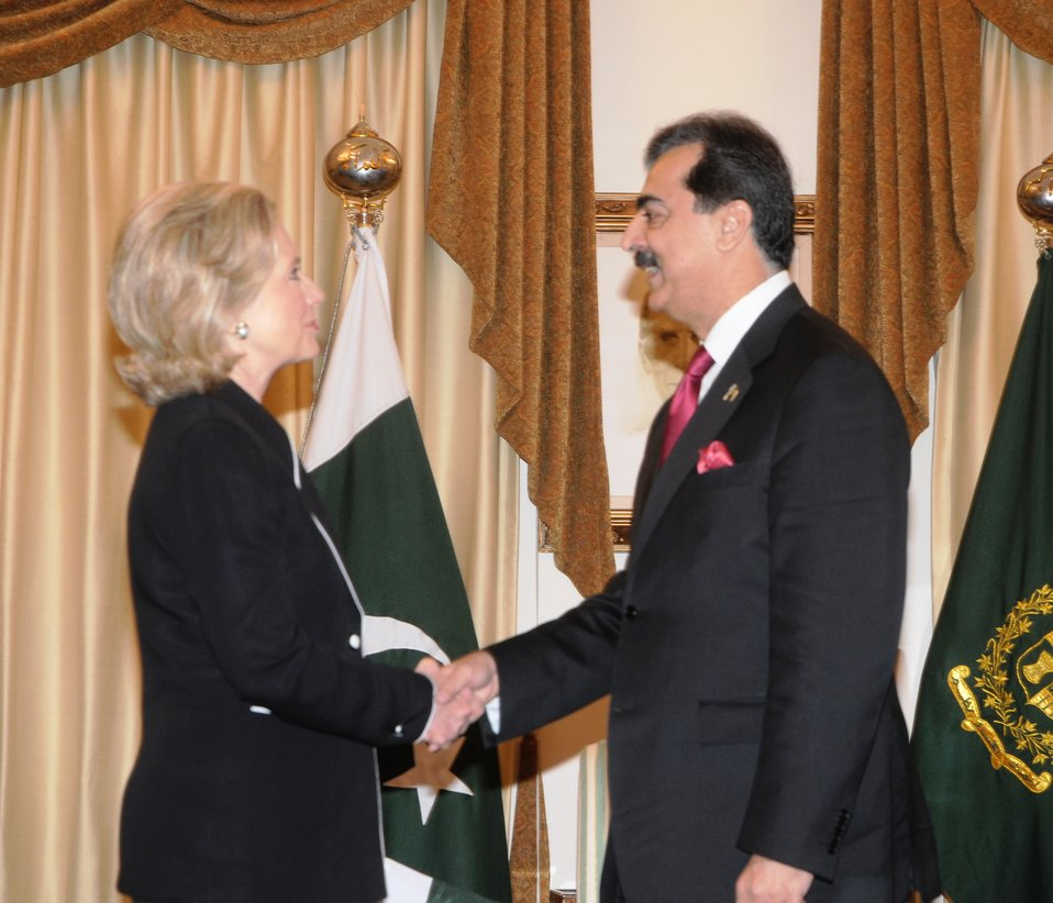 Secretary Clinton Is Greeted By Pakistani Prime Minister Yousaf Raza Gilani