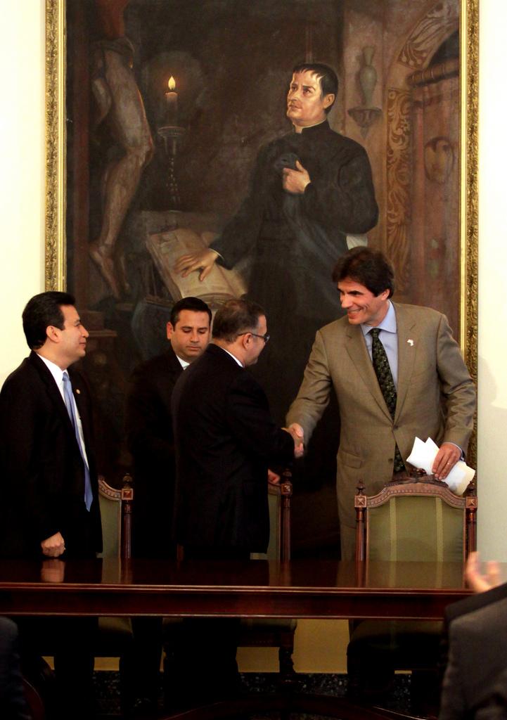 Assistant Secretary Fernandez Shakes Hands With Salvadoran President Funes