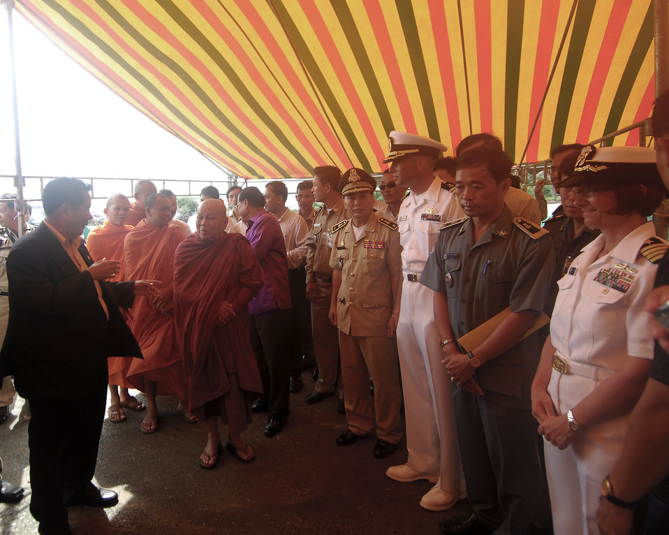 Cambodian Ministry of Culture Director, Capt. Franchetti, and First Mate Matthew Bush Greet Buddhist Monks