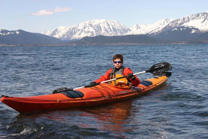 Boy Paddling in Kayak