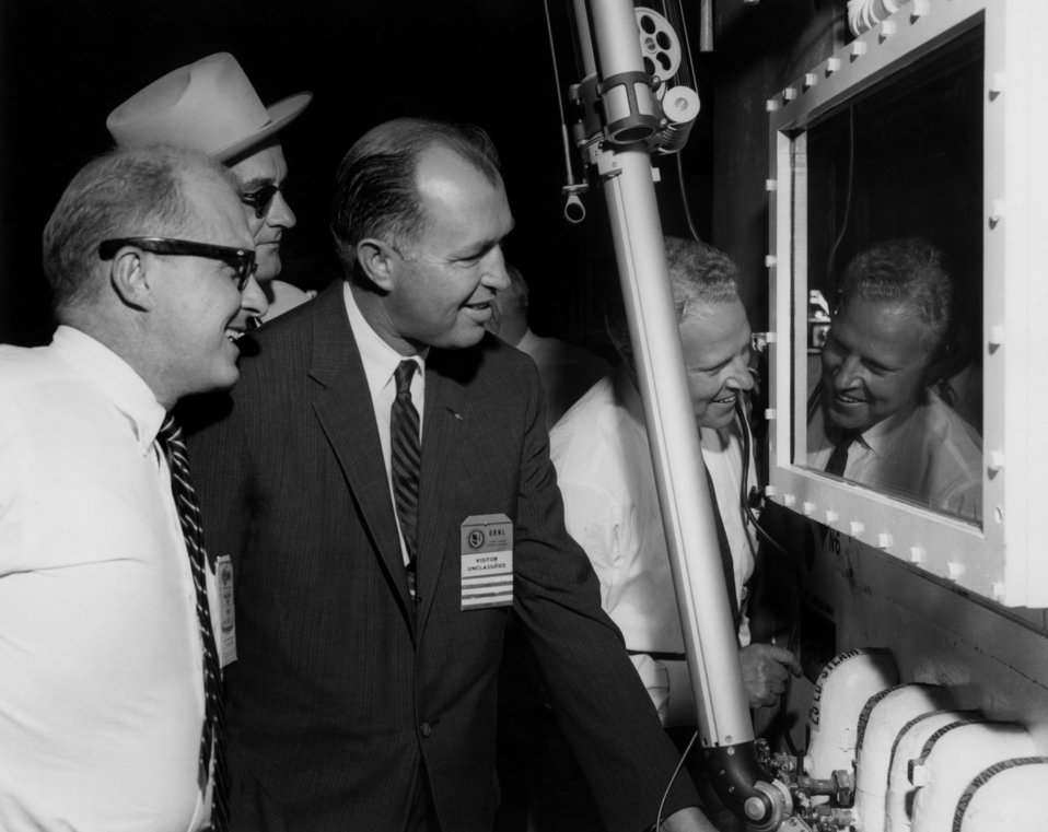 WestcottCayce Pentecost, Senator Lyndon Johnson, Buford Ellington, Senator Albert Gore, operating mechanical hands at hot cell in Oak Ridge