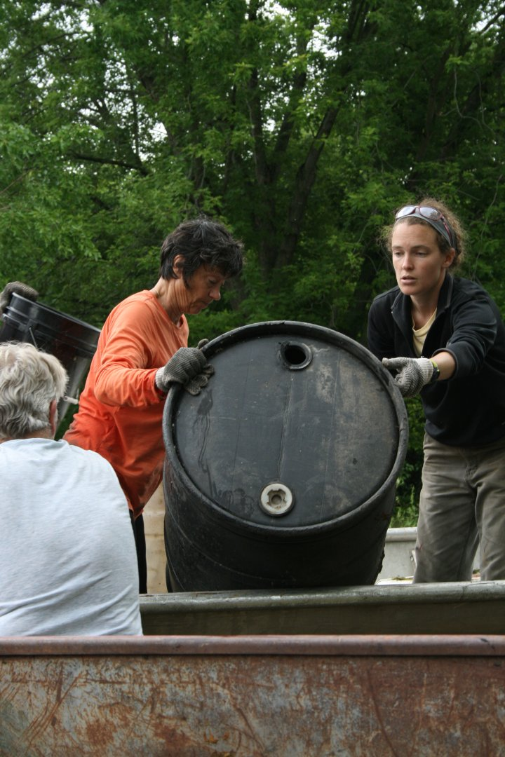 Volunteers Christine and Sarah unload a barrel