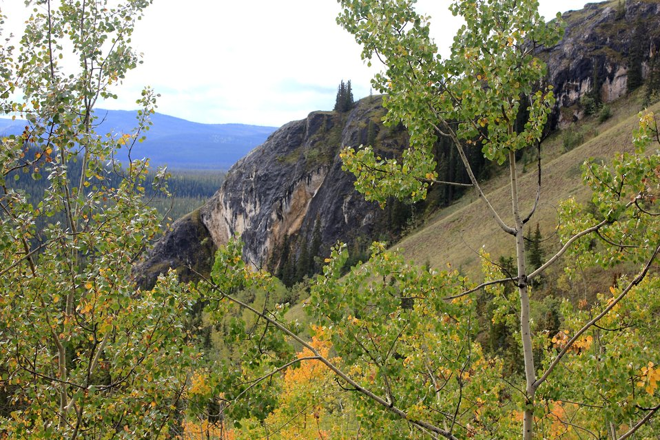 A view along the Dempster Highway while traveling above the Yukon River. This is known as the Den of the Giant Frog, Ts'al Cho An in northern Tutchone, an Athabascan native language. This is shown on Chief Kohklux's map of the Yukon.