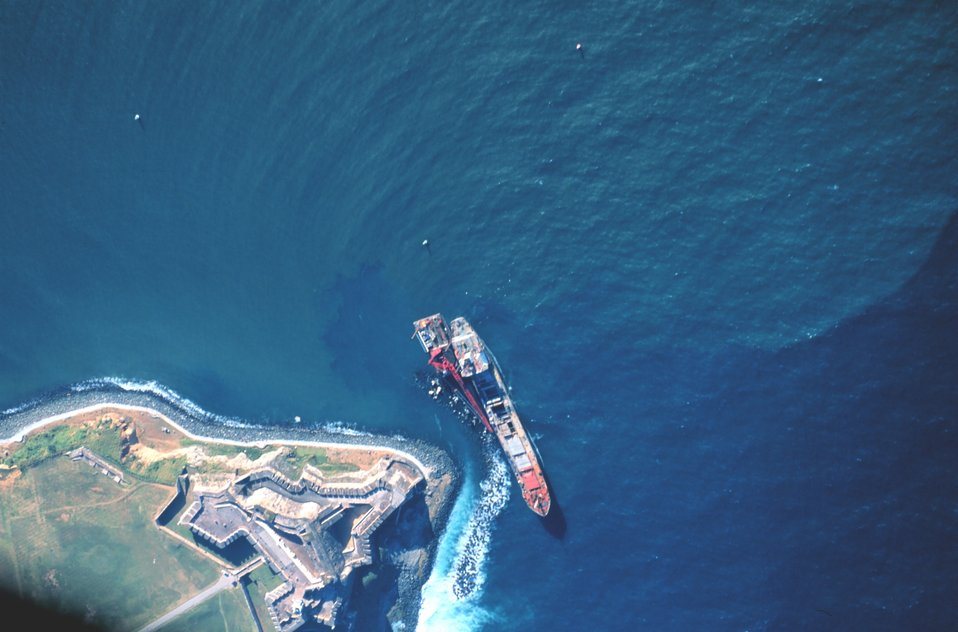 A grounded Russian merchant vessel off the El Morro at the entrance to San Juan Harbor.