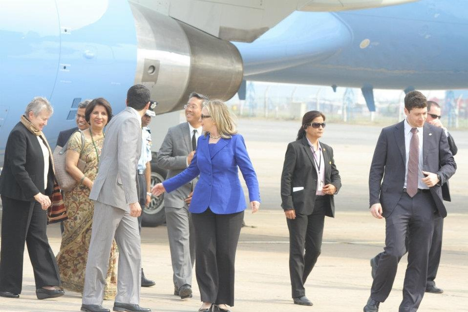 Secretary Clinton Is Welcomed By Ambassadors Powell and Rao