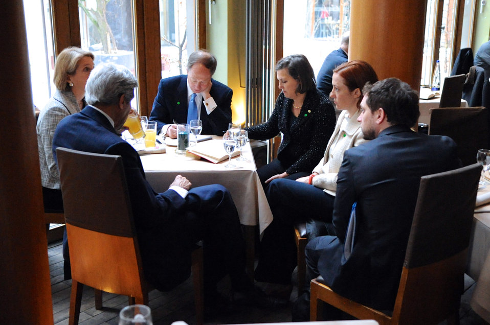 Secretary Kerry Meets With Staff at a Berlin Restaurant