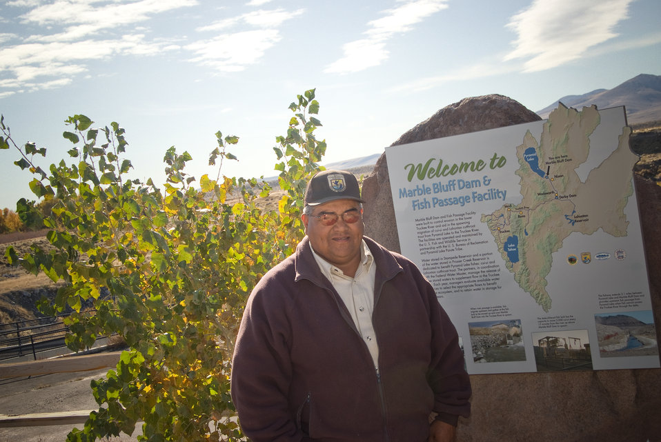 Roy Hicks, Tractor Operator with the Pah Rah Mountains and the Truckee River in the background