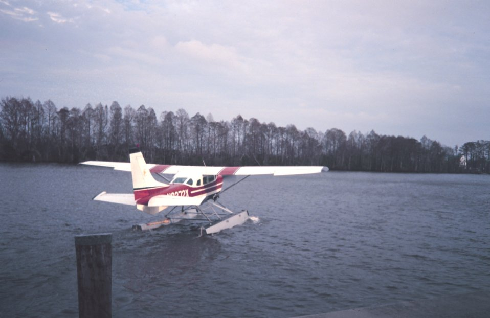 Seaplane taking off from the Tchefunte River to East Timbalier Island area.