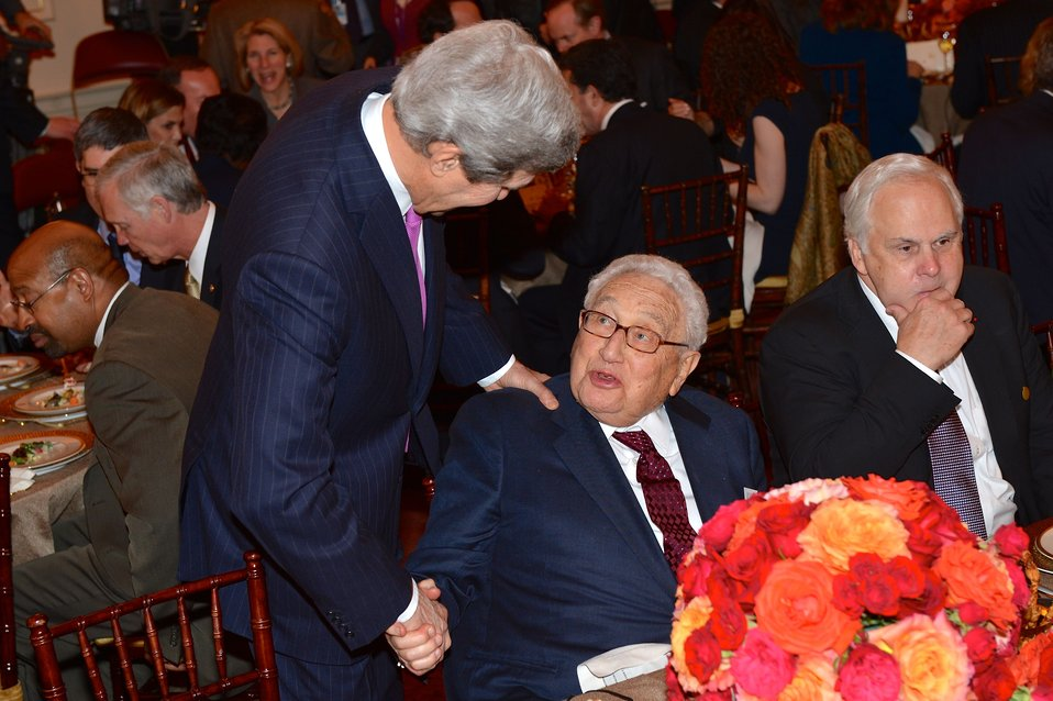 Secretary Kerry Shakes Hands With Former Secretary Kissinger