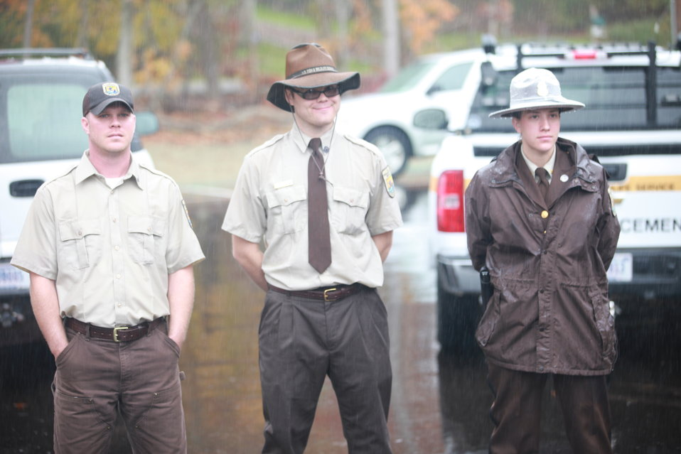 Refuge staff stand in the rain at Visitor Center Opening Event