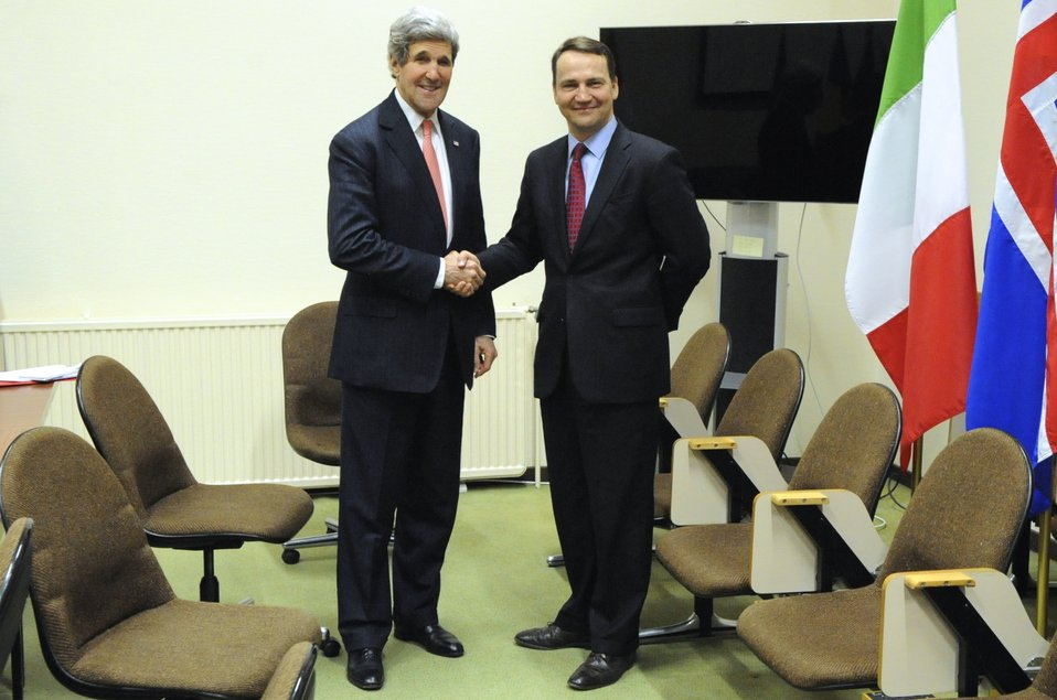 Secretary Kerry Poses With Polish Foreign Minister Sikorski in Brussels