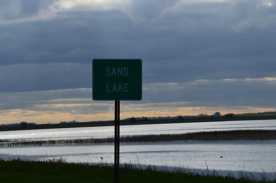 Close-up of Sand Lake sign
