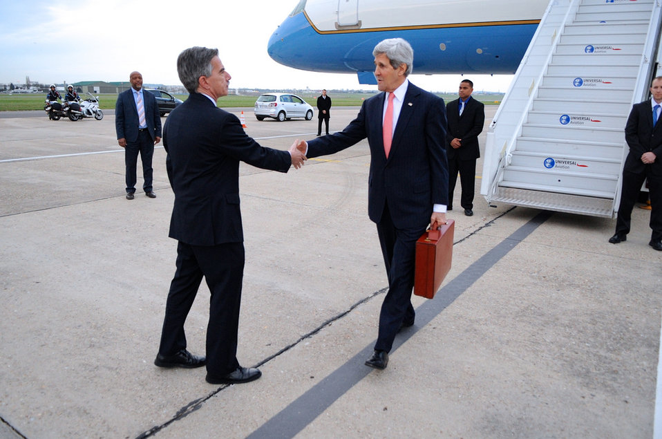 Secretary Kerry is Greeted by Charge d'Affaires Taplin Upon Arrival in Paris