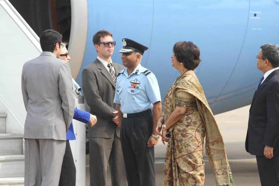 Secretary Clinton Is Welcomed By Ambassador Rao