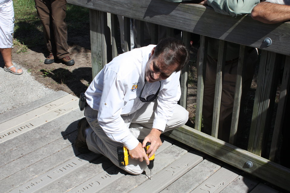 Director Dan Ashe places plank