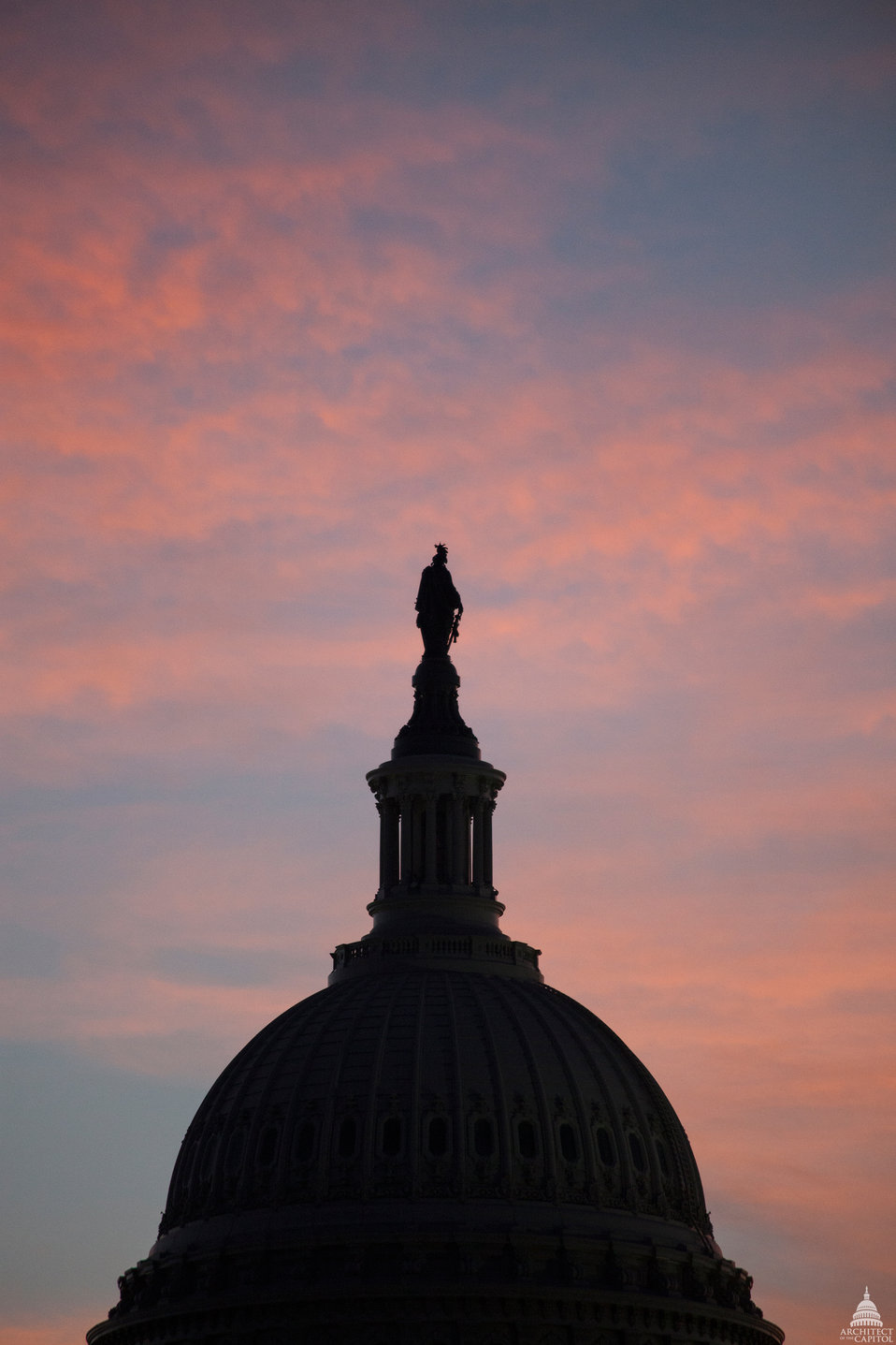 Freedom silhouette atop the Capitol Dome
