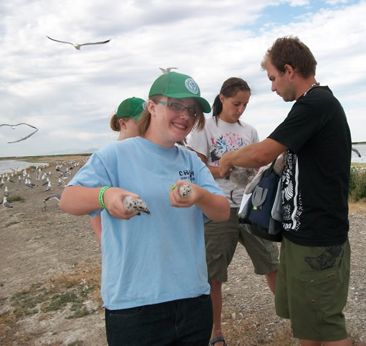 YCC participant holds young birds