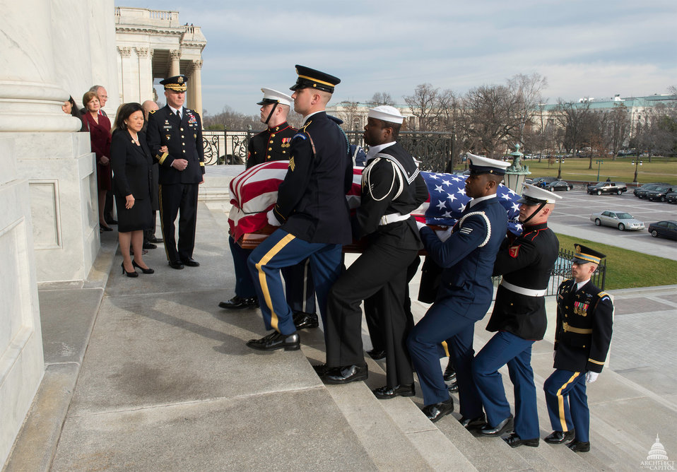 Honor Guard carries Senator Inouye into the U.S. Capitol for Lying in State