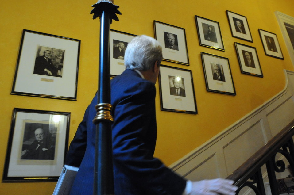 Secretary Kerry Looks at British Prime Minister Portraits in No. 10 Downing Street