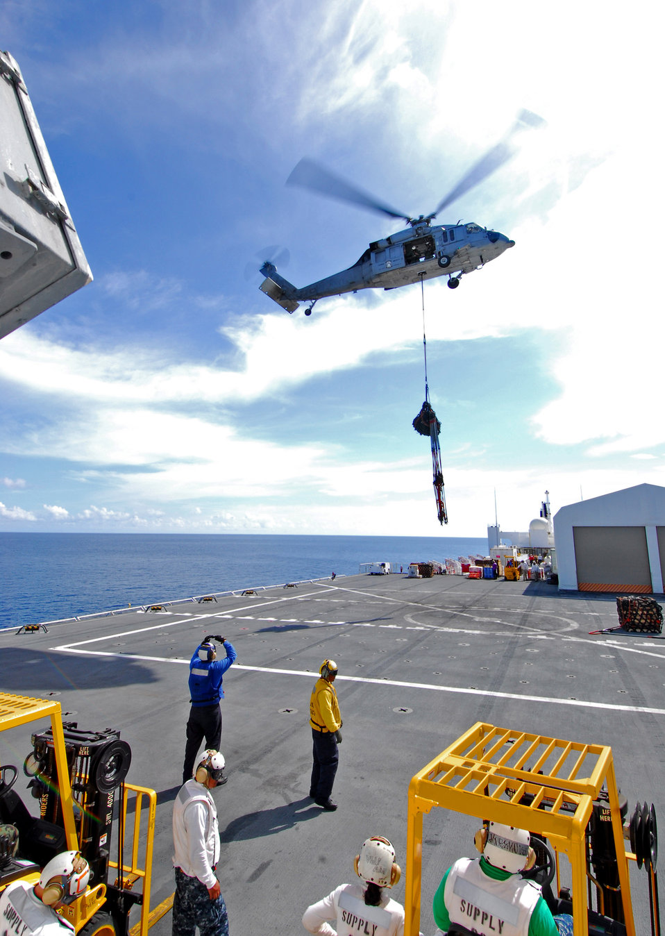 An MH-60S Knighthawk Helicopter Conducts a Vertical Replenishment (VERTREP)