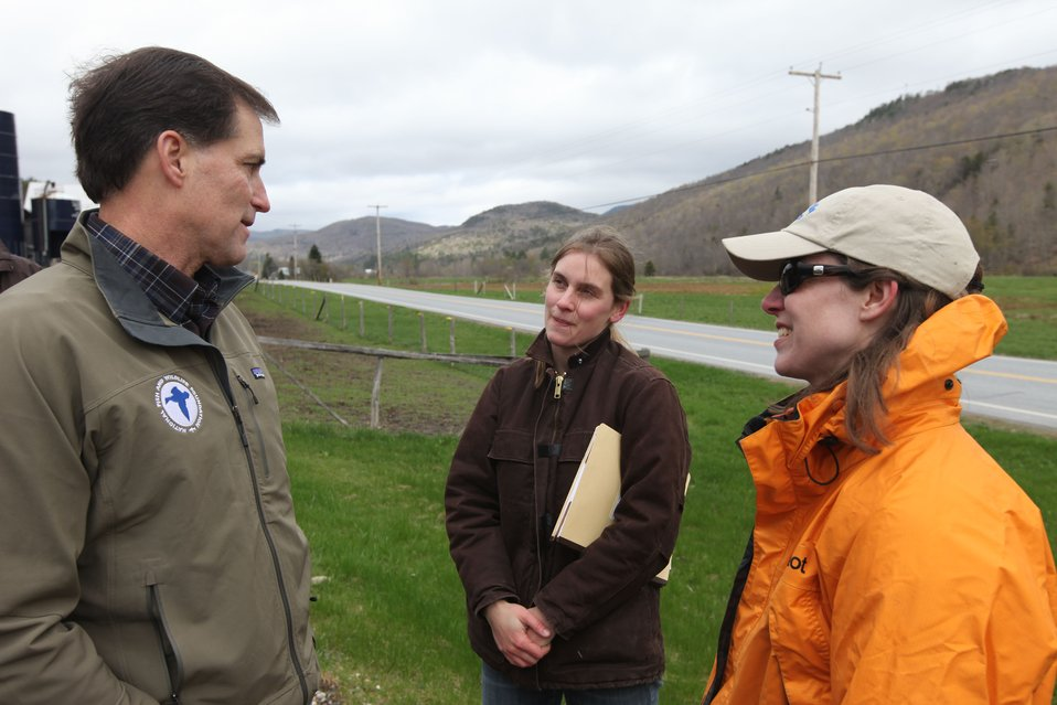 Dan Ashe speaks with White River Partnership staff at riparian restoration site