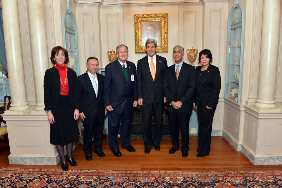 Secretary Kerry Poses for a Photo With Kenneth Kannappan of Plantronics, Inc. in Mexico