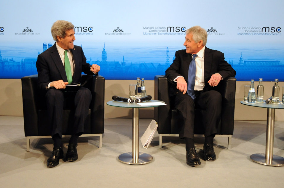 Secretaries Kerry, Hagel Share a Laugh Before a Joint Panel Discussion at Munich Security Conference