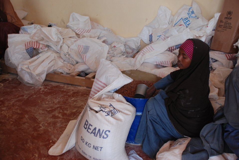 A Camp Worker in Dadaab, Kenya Prepares to Distribute Food Provided by the U.S.