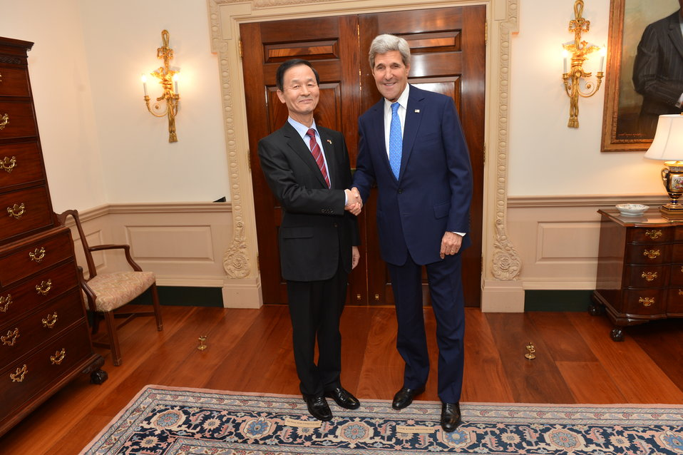 Secretary Kerry Shakes Hands With Republic of Korea Director of National Security Kim Jang-soo