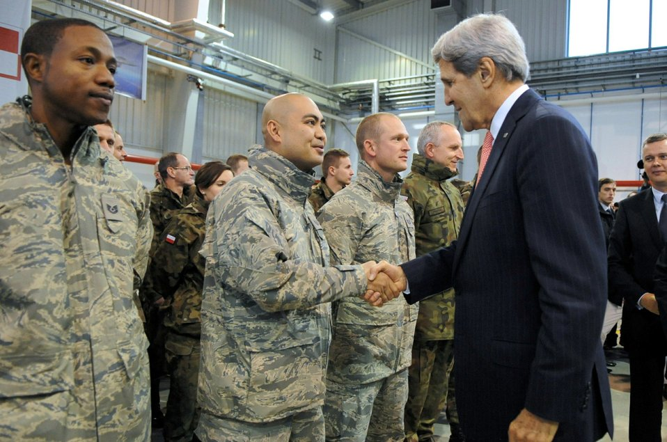 Secretary Kerry Greets a U.S. Air Force Member in Poland