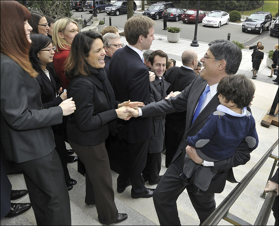 Staff welcome Secretary Lew to the Treasury Department right after his swearing-in ceremony
